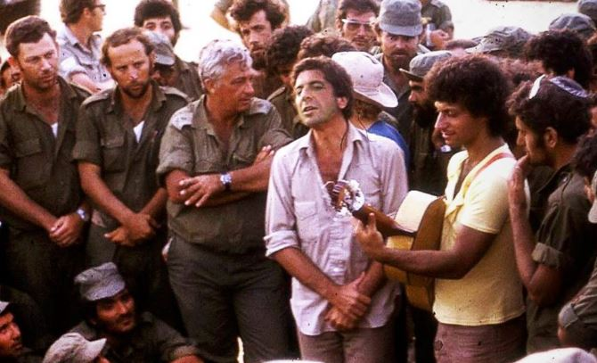 Leonard Cohen performing for the IDF, with Ariel Sharon looking on.