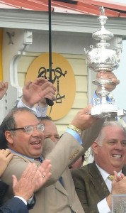 Ahmed Zayat holding the trophy at the 2015 Preakness Stakes